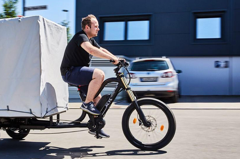 Big Dudes ride heavy cargo bikes